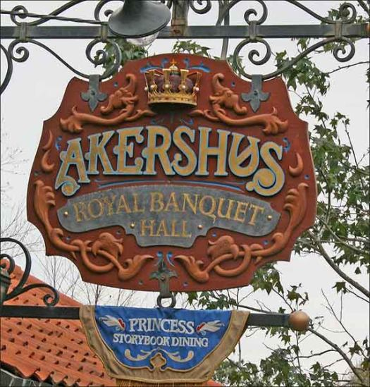 The sign for Akershus Royal Banquet Hall that has a flag that says Storybook Dining