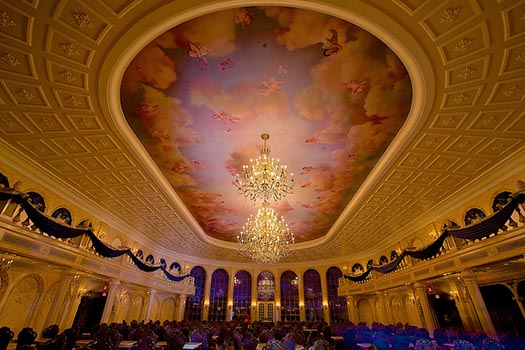 The Ballroom of Be Our Guest with the big mural on the ceiling