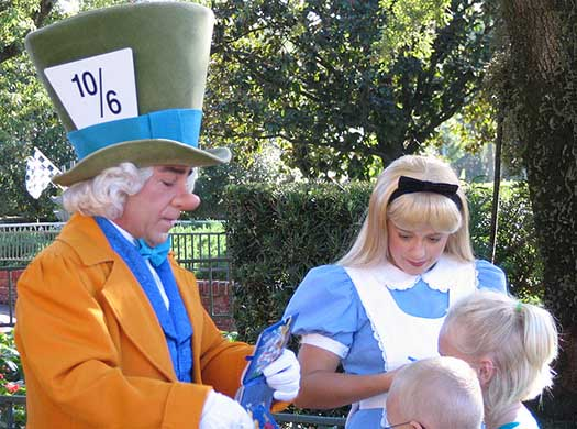 The Mad Hatter and Alice signing autographs