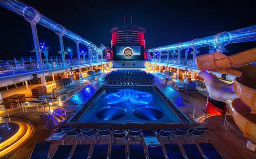 The pool area of the Disney Fantasy at night
