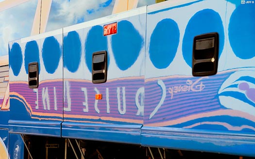 The Disney Magical Express bus reflects the Disney Cruise Line bus