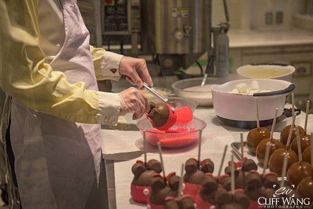 Watch candy apples being made