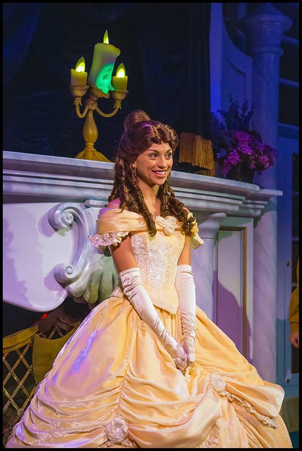 Belle waits to greet her guests at Enchanted Tales with Belle