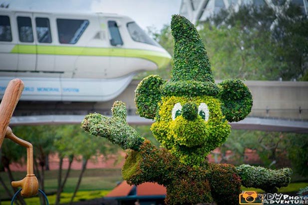 Mickey Mouse topiary in front of the monorail