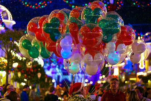 Disney Balloons on Main Street USA with snow on them