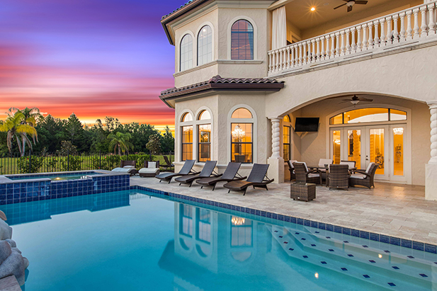 A luxury deck and pool at a vacation home near Disney World
