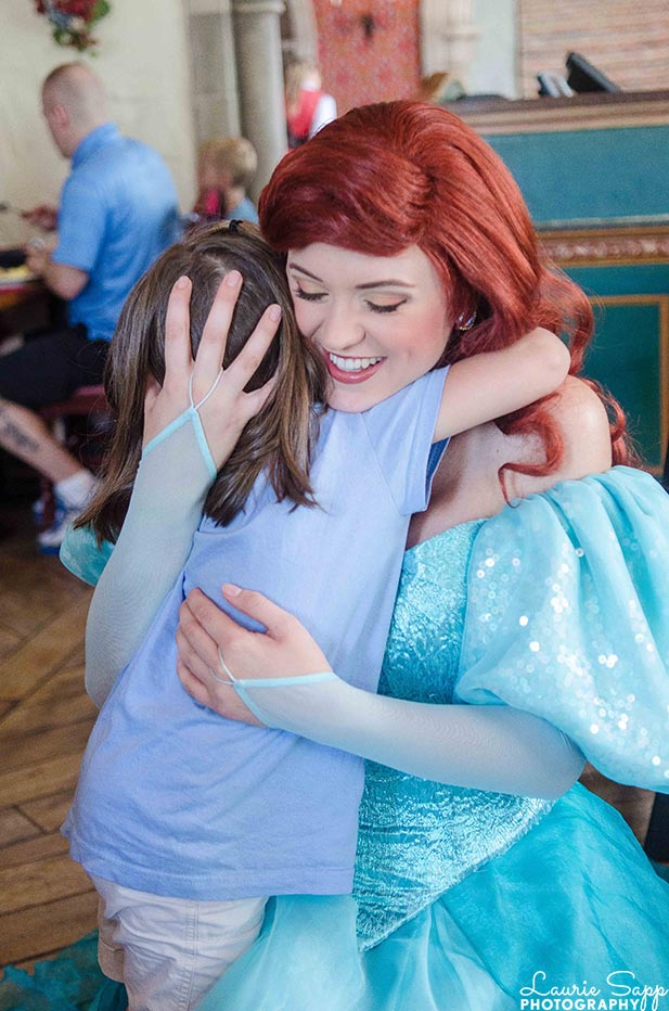 A little girl hugging Ariel at the Princess Fairytale Breakfast