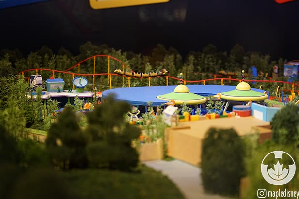 The Toy Story Land model showing Slinky Dog Dash Roller Coaster and Alien Swirling Saucers