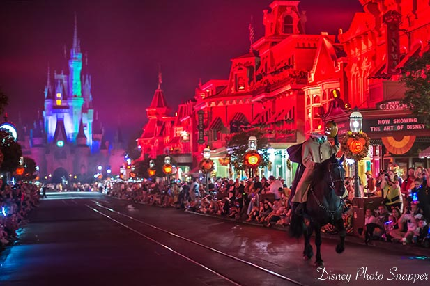 The Headless Horseman riding down Main Street USA with Cinderella Castle in the background