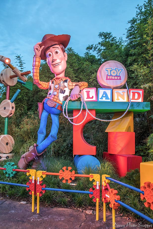 Woodie at the entrance to Toy Story Land