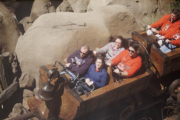 Dad and the family on the Seven Dwarfs Mine Train from PhotoPass