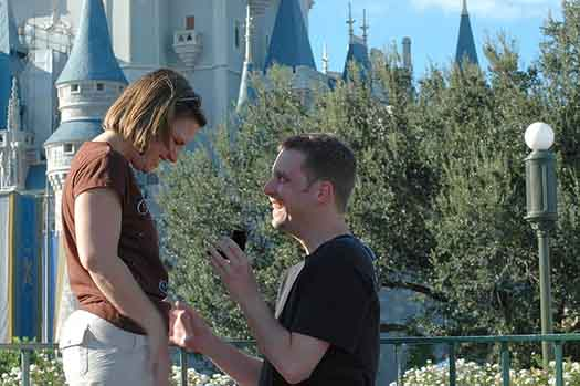 A proposal in front of Cinderella Castle