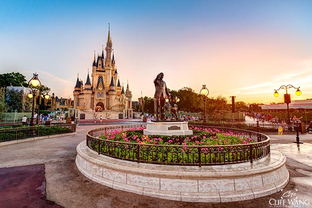 The morning sun over Cinderella Castle means a hot day