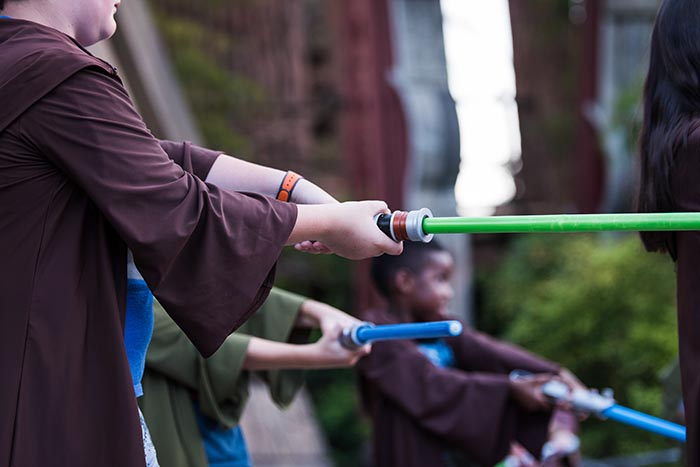 Learning how to use a Light Saber at Jedi Training Academy
