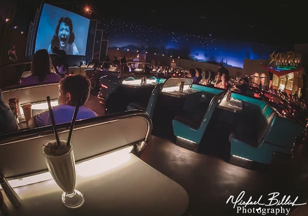 A milkshake sitting on a table in the Sci Fi Dine In restaurant at Disney's Hollywood Studios