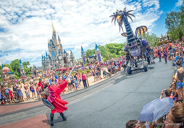 Maleficent fighting a knight in the Festival of Fantasy parade