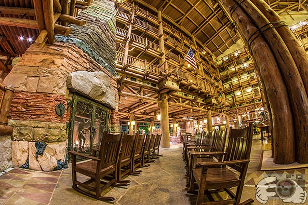 The rocking chairs in front of the fireplace in the Wilderness Lodge atrium
