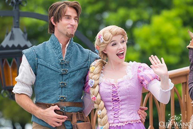 Rapunzel and Flynn Rider on a float in the Festival of Fantasy Parade