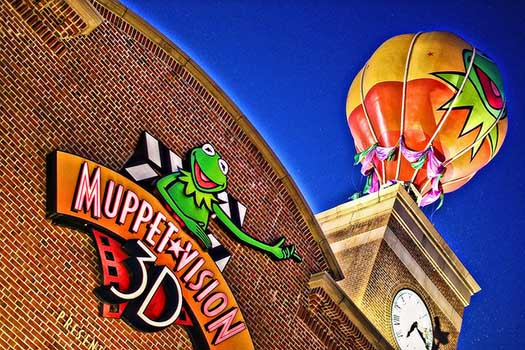 The sign at Muppetvision 3D with the Muppet balloon in the background