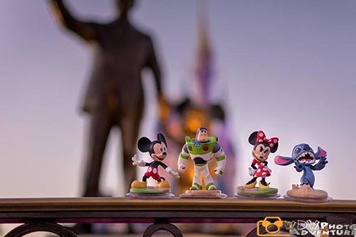 Mickey Mouse, Buzz Lightyear, Minnie Mouse and Stitch dolls with Cinderella Castle and Walt in the background