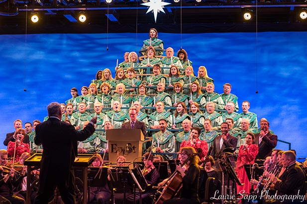 The conductor leading the Candlelight Processional