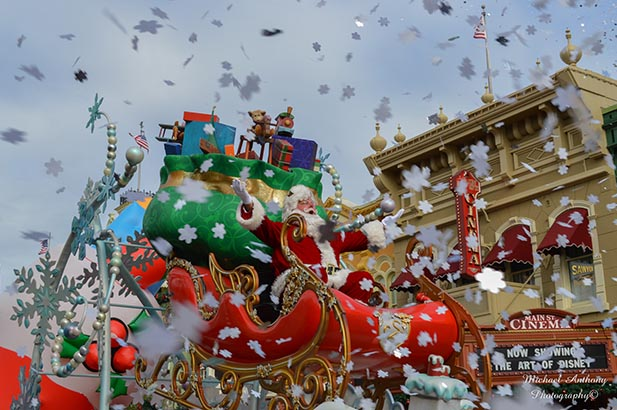 Santa rides through the snowflakes in the Christmas Day Parade.