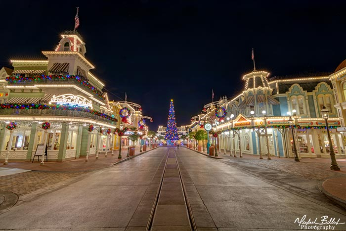 Main Street USA decorated for Christmas staying late may be a way to beat the Christmas Day lines at Magic Kingdom
