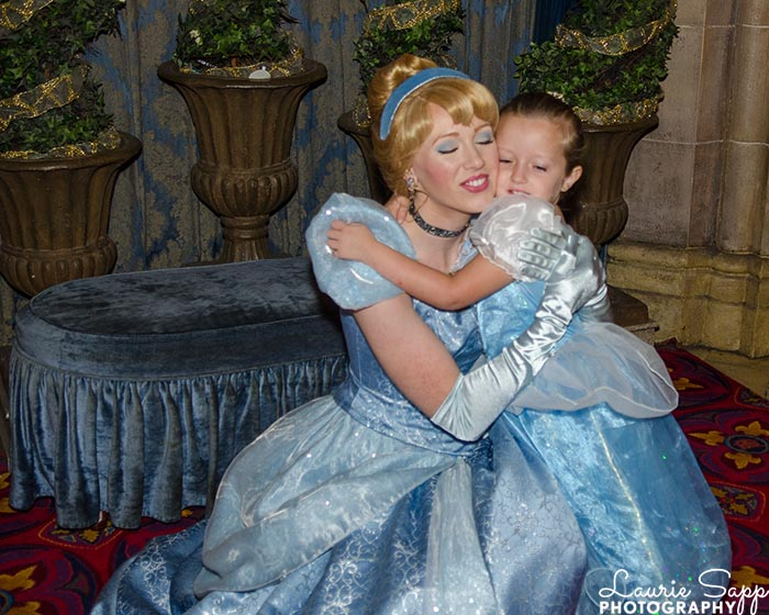 Maddie giving Cinderella a hug at a Princess Party for a 4 year old