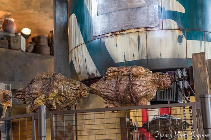 "The fire pit at Ronto Roasters in Star Wars: Galaxy's Edge with Batuu animals ""roasting"""