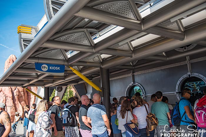 a crowds around a FastPass Kiosk in the Magic Kingdom will not happen with crowd for September 2020