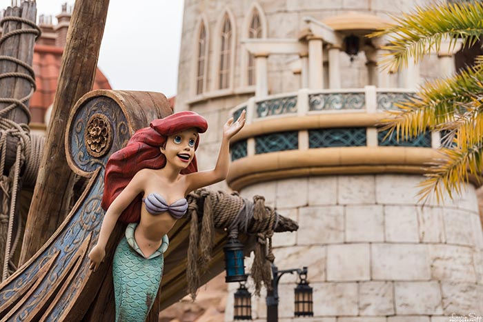 Ariel from the Little Mermaid on the front of Prince Eric's boat in Fantasyland